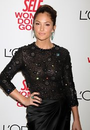 Minka paired her beaded cocktail dress with turqouise dangle earrings.