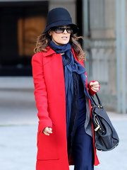 Salma Hayek topped off her winter look with a cute cloche.