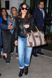 Salma Hayek teamed her jacket with a pair of boyfriend jeans.