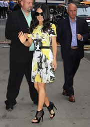 Salma showed off her curves in this yellow, black, and white printed frock, which she belted to show off her tiny waist.