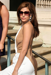 Eva Mendes struck a fierce pose at the Salvatore Ferragamo Resort 2012 show in square tortoise sunglasses.