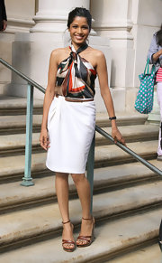 Freida Pinto kept her look summery at the Salvatore Ferragamo Resort 2012 show with a pair of brown leather ankle strap wedges.