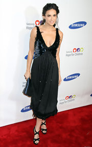 Demi looked divine at the Samsung benefit in a sequined and feathered black dress.