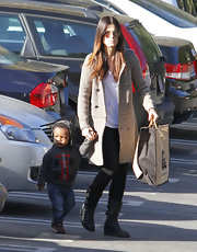 Sandra Bullock warmed up in a knit heather gray duster.