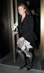 Sarah Ferguson once again wowed us to her choice of scarves as she was spotted carrying one at the Novikov Restaurant.