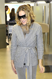 Sarah Jessica Parker tucked a beige linen scarf into her wrap sweater at the Berlin Airport.