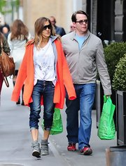 Sarah Jessica Parker chose a vibrant orange cardigan for her look while out with her family in NYC.