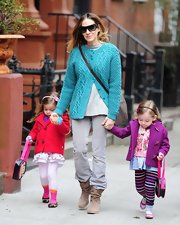 Sarah Jessica Parker added some color to her every day look with this turquoise cardigan.