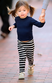Holding tight to Mom Sarah Jessica Parker's hand in NYC, Tabitha Broderick looks comfy and cute in her black-and-white striped leggings and simple navy tee.