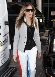 Sarah Jessica Parker looked sporty in her shield sunglasses while shopping at Bloomingdale's.