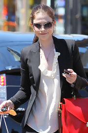 Michelle paired her sleek blazer with cool butterfly shades.