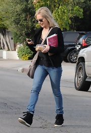 Sarah Michelle Gellar chose a pair of trendy black basketball sneakers with a stylish wedge for her look while out in LA.