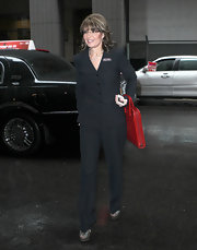 Sarah Palin kept things sophisticated in a tailored black suit accessorized with a red briefcase.