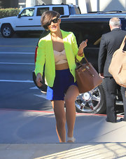 Frankie Sandford brightened up LA in a highlighter yellow blazer worn over a teeny tiny crop top.