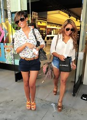 Frankie Sandford topped off her casual look with a pair of navy short shorts.