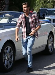 Scott Disick opted for a light-wash ripped jean for a casual daytime look.