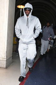 Sean Combs looked sporty in gray sweatpants and a matching hoodie as he arrived on a flight at LAX.