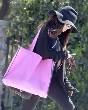 Selena Gomez added a black floppy hat for her bohemian-style look while out in California.