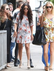 Selena Gomez contrasted her girly frock with edgy white mesh boots by BCBG Max Azria.