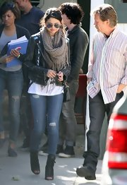 An oversized knit scarf with fringe gave Selena Gomez a casual but chic look while out in California.