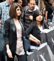 Selena Gomez looks fierce in her black blazer over a pink tank while out shopping.