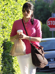 Selma Blair gave her casual look a feminine touch with a pink button up shirt.