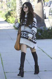 Selena looked so cute in her slouchy sweater dress with knee-high socks.