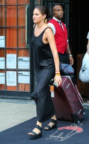 Shailene Woodley cut a sultry figure in this clingy black maxi dress while leaving the Bowery Hotel.