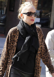 Sharon Stone donned a black pashmina with her leopard print cardigan while out and about.