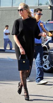 Sharon Stone looked ultra elegant in a draped black dress and lace stockings while out in Brentwood. Gold hoops and Hollywood shades finished off her chic style.