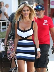 Shauna Sand flaunted her fab figure in a tricolor cutout dress during a reality TV show shoot in Los Angeles.