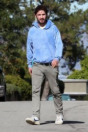Shia LaBeouf paired a baby-blue hoodie with chinos for a stroll in LA.