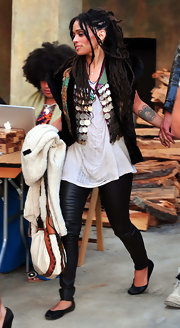 Lisa Bonet attended a fundraiser wearing a colorful vest paired with her oversize white T-shirt and leather leggings.