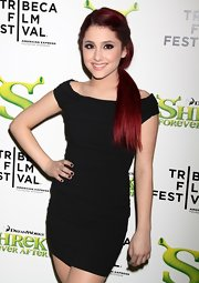 Ariana rocked a vibrant red hairstyle with a loose, side ponytail and a twisted design.