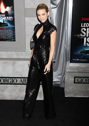 AnnaLynne debuted a very different look in a leather cutout jumpsuit.