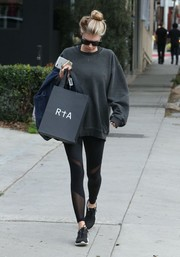 Charlotte McKinney went shopping in West Hollywood dressed down in an old black sweatshirt.