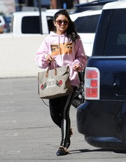 Vanessa Hudgens dressed down in a pink hoodie printed with Elvis Presley's eyes for a day out in Studio City.