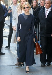 Sienna Miller made her way to the 'Good Morning America' studio wearing a black wide-leg, crossover jumpsuit by Celine.