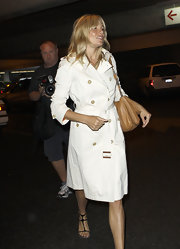 Sienna paired her classic trench coat with patent gladiator sandals.