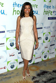 Taraji was stunning at the Silver Rose Gala in a pearl bandage dress and peep-toe pumps.