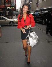 Jenni Farley tamed her fitted LBD with a sophisticated red wrap blouse.