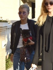 Sofia Richie went shopping at Barneys carrying not one but two arm candies: a Louis Vuitton Palm Springs mini backpack and a very cute puppy!