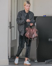For her arm candy, Sofia Richie chose a biker-chic leather tote.