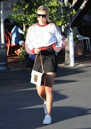Sofia Richie kept her feet comfy in white canvas sneakers by Vans.