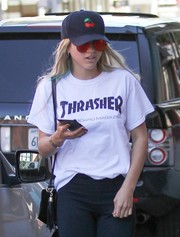 Sofia Richie strolled in Beverly Hills wearing a cherry-embroidered baseball cap and a pair of orange shades.