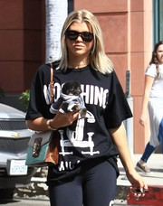 Sofia Richie shielded her eyes with a pair of wayfarers while strolling on a sunny day.