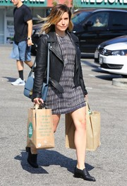 Sophia Bush styled her dress with a black leather biker jacket.