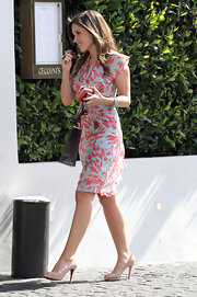 Sophia Bush teamed her feminine petal print dress with nude platform peep-toes.