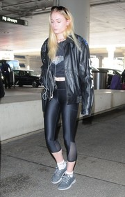 Sophie Turner completed her travel outfit with gray Adidas Yeezy 350 Boost sneakers.