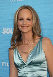 Actress Helen Hunt attended the 'Soul Surfer' event with sleek straight locks parted down the center.